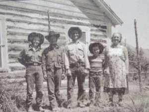 Black-and-white photos on interpretive signs show Rial Chew and his family in 1955.